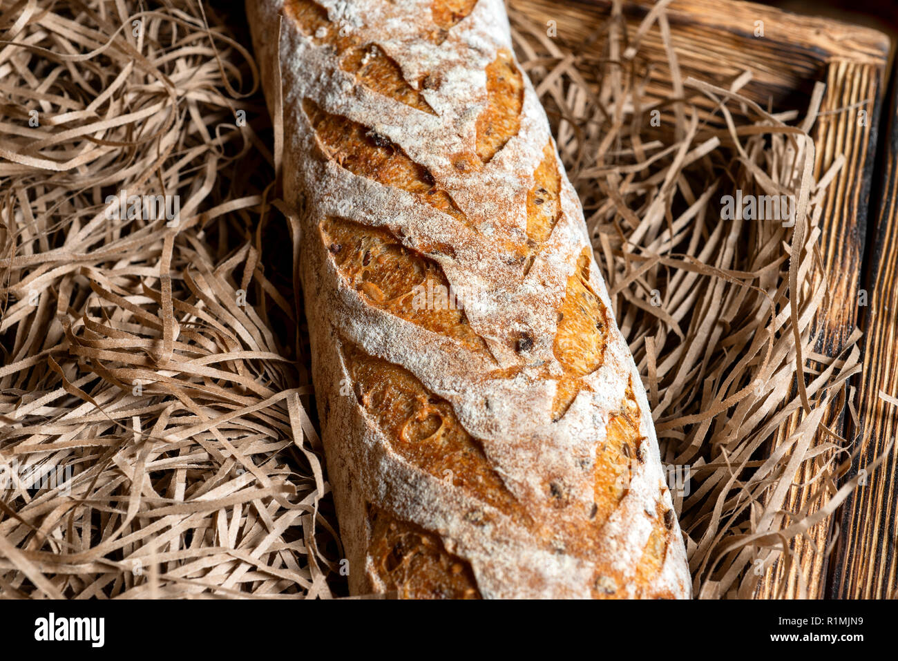 Fresh Bread on brown craft paper on a shop window. Texture and background. - Stock Image