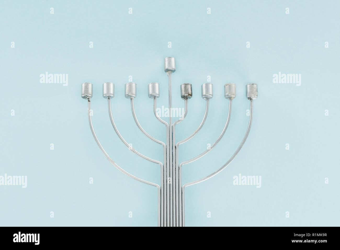top view of traditional menorah on blue backdrop, hannukah celebration concept - Stock Image