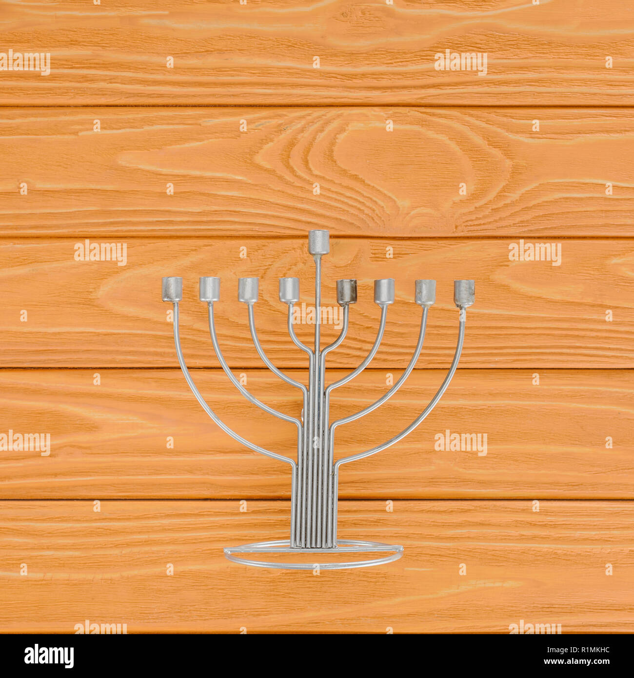top view of menorah on wooden surface, hannukah holiday concept - Stock Image
