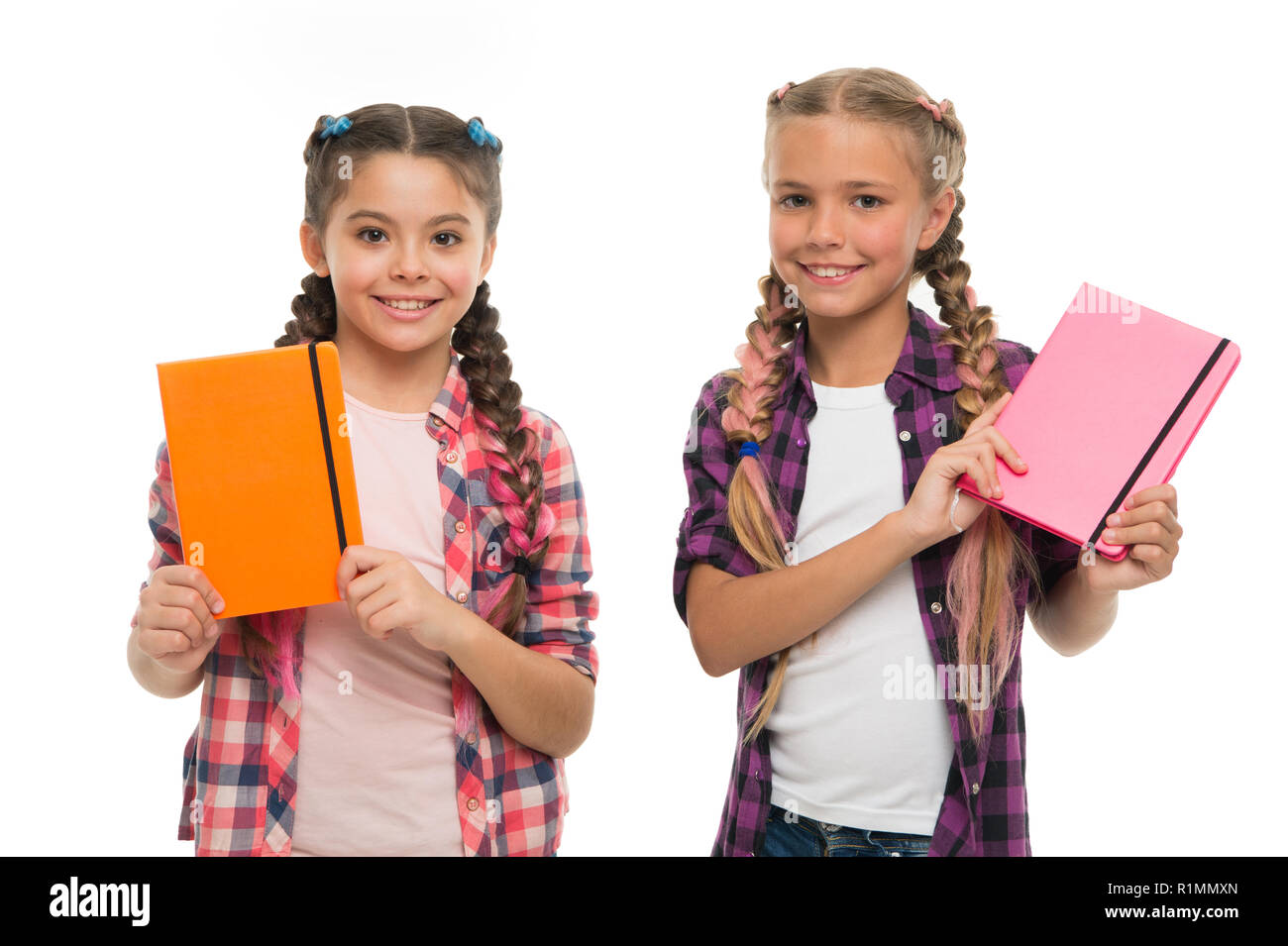 Children cute girls hold notepads or diaries isolated on white background. Note secrets down in your cute girly diary journal. Diary writing for children. Childhood memories. Diary for girls concept. - Stock Image