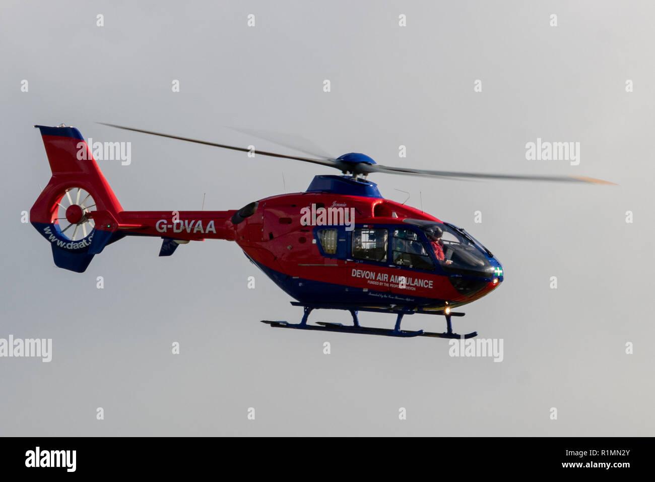Devon Air Ambulance taking off from a farm near Barnstaple, North Devon 11th Nov 2018. - Stock Image