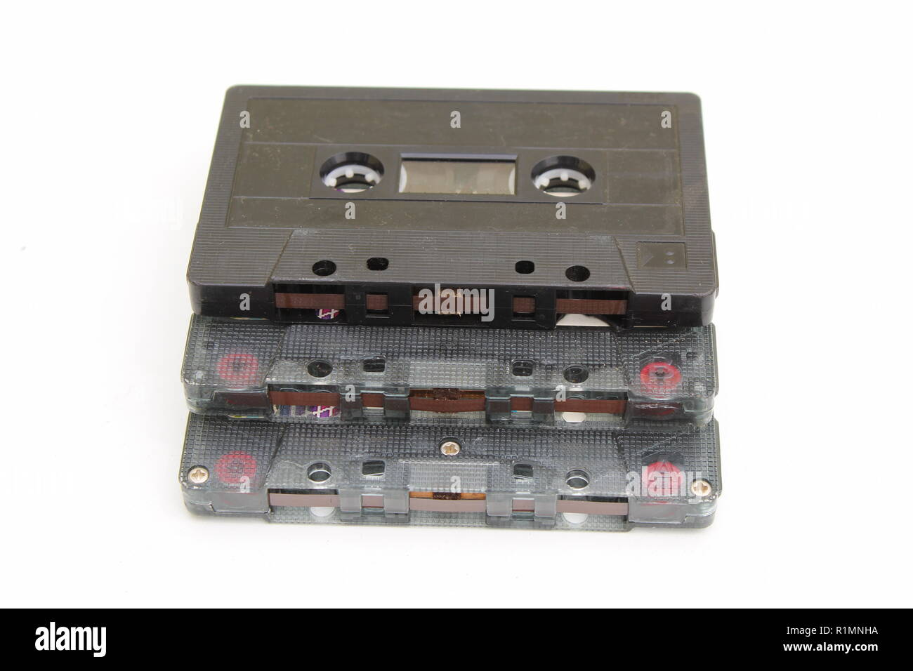 Three magnetic cassette tapes stacked on white background Stock Photo
