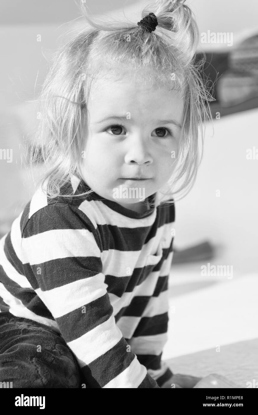 child. cute child in striped clothes. happy childhood of little boy child. child with blong hair. stylish and cute - Stock Image