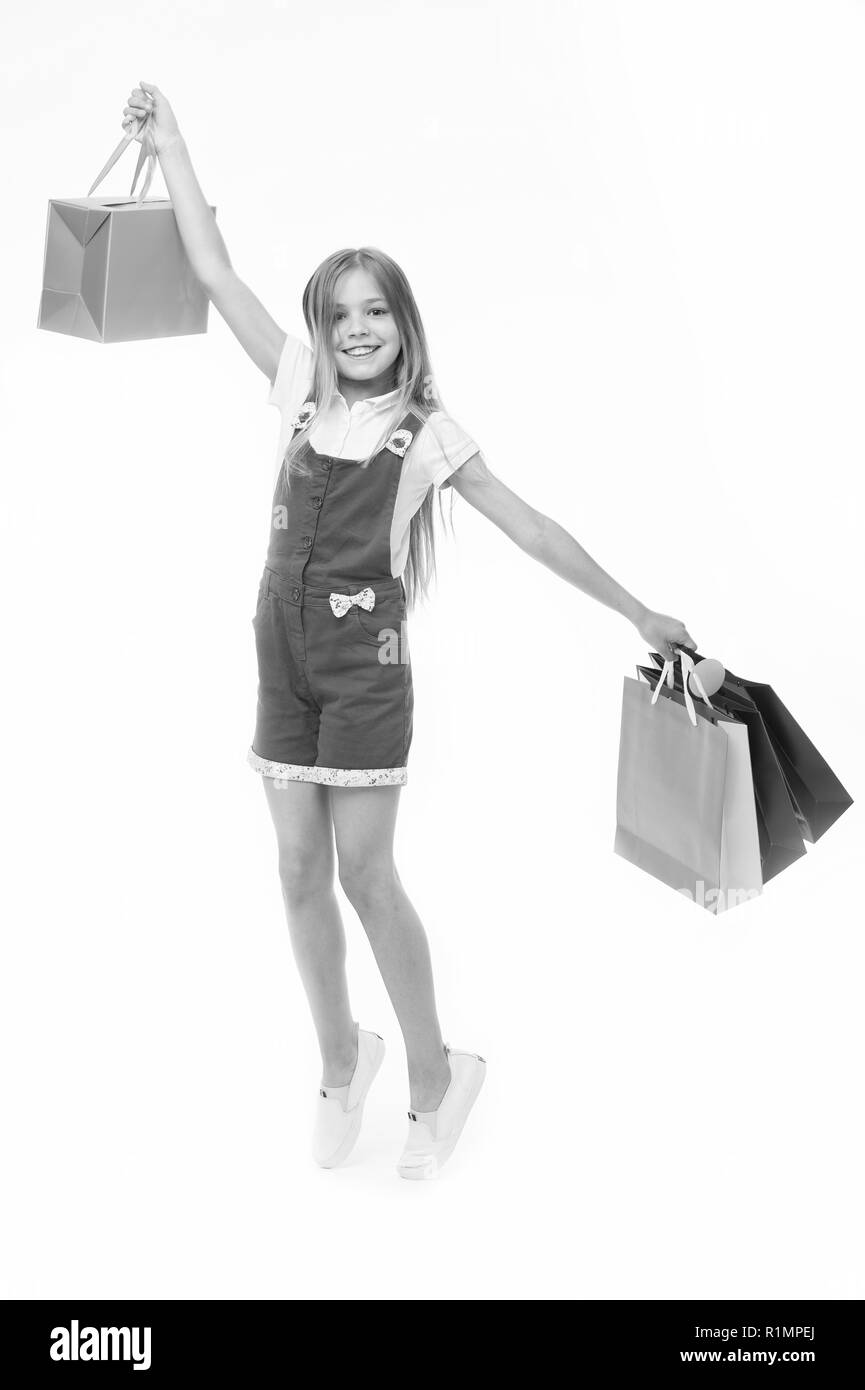 Top tips for smart kid clothes shopping. Girl cute teenager carries shopping bag. Kid bought clothing summer sale. Loyalty benefits. Why customers participate in loyalty programs. - Stock Image