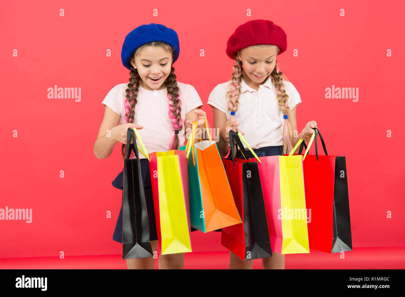 Children satisfied by shopping red background obsessed with shopping and clothing malls shopaholic concept shopping become fun with best friends
