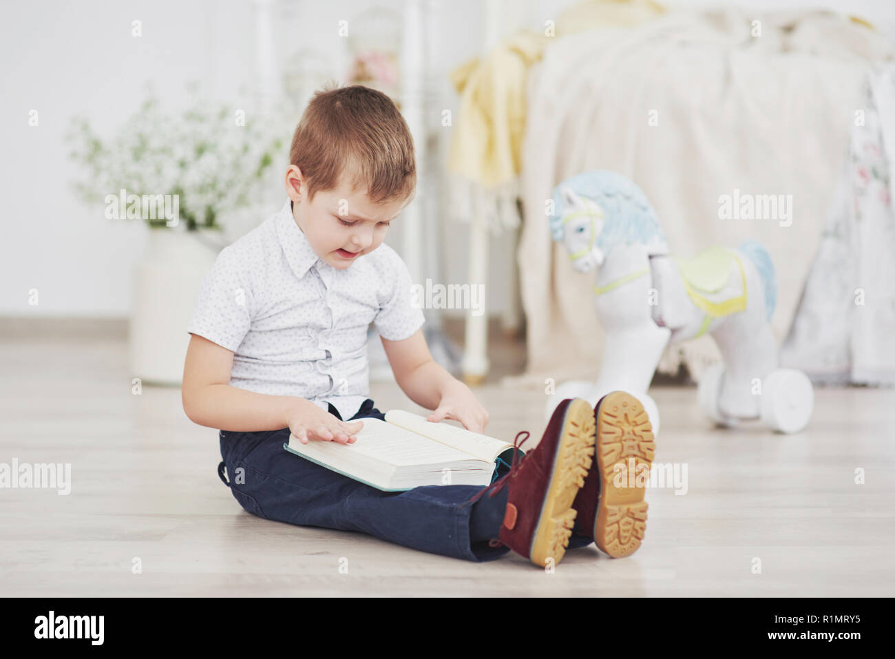 Boy reading a book  Education, Knowledge, getting ready for