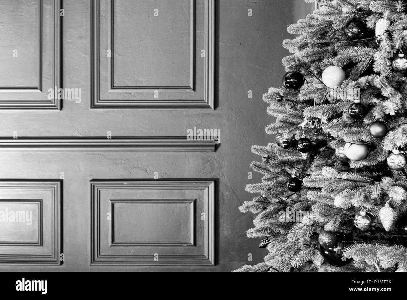Christmas morning, Background, red wall, royal interior, Christmas fluffy, Christmas tree. Copy space - Stock Image