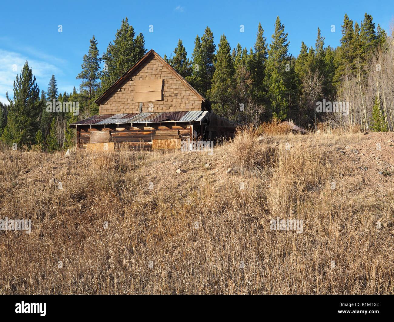 An old mine building near Breckenridge Colorado.  The photo was taken in the late afternoon when the sun was getting low in the sky. - Stock Image