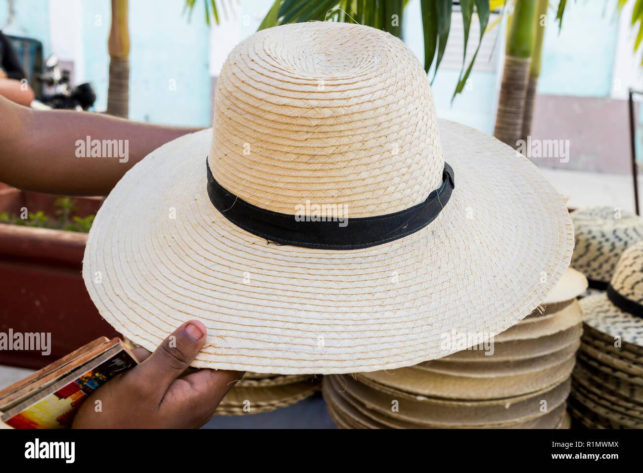 928184a9 Display of straw hats for sale in Cienfuegos Cuba - Street market -  Handcraft - Stock