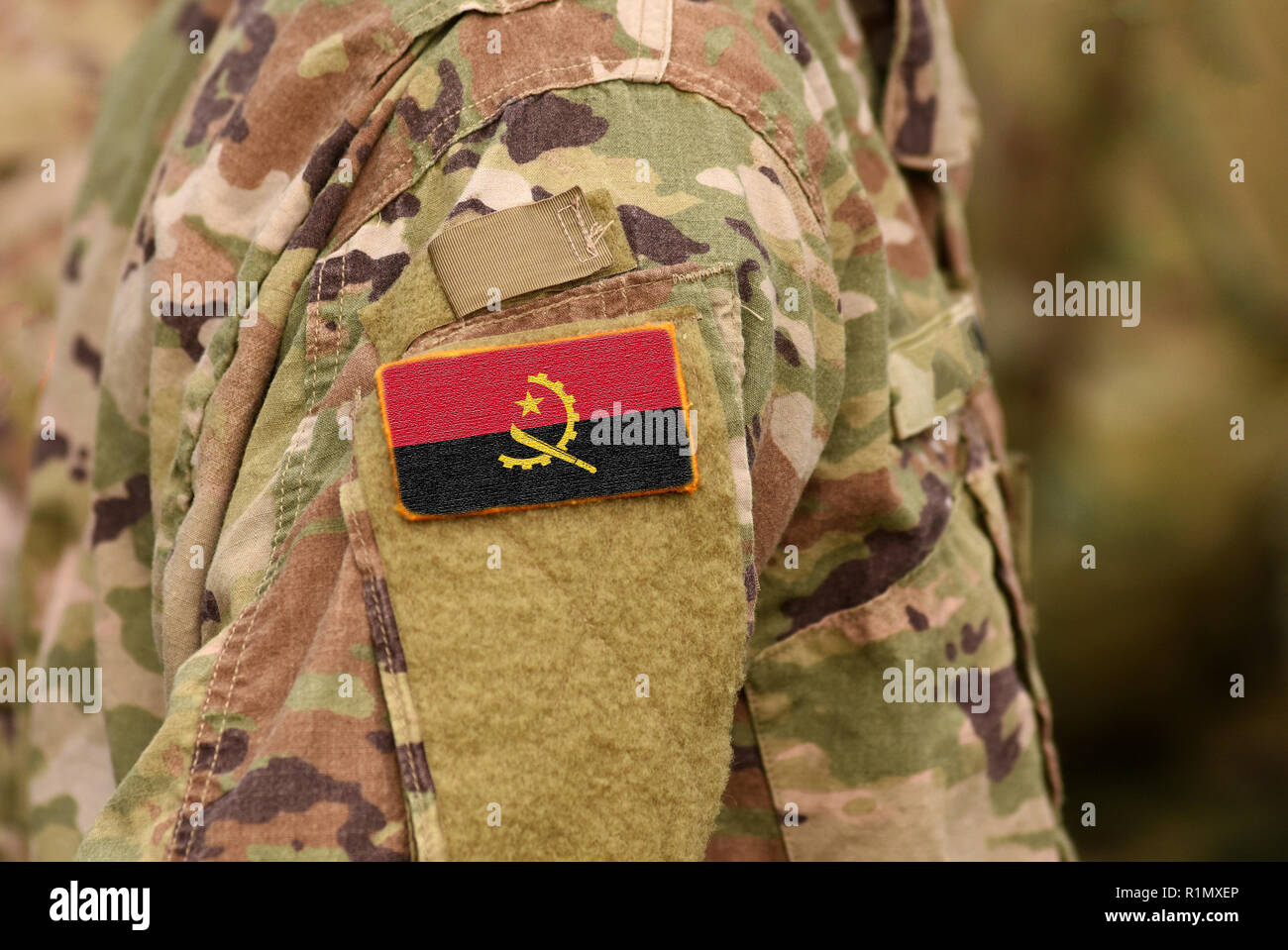 Angola flag on soldiers arm. South Republic of Angola troops (collage) - Stock Image