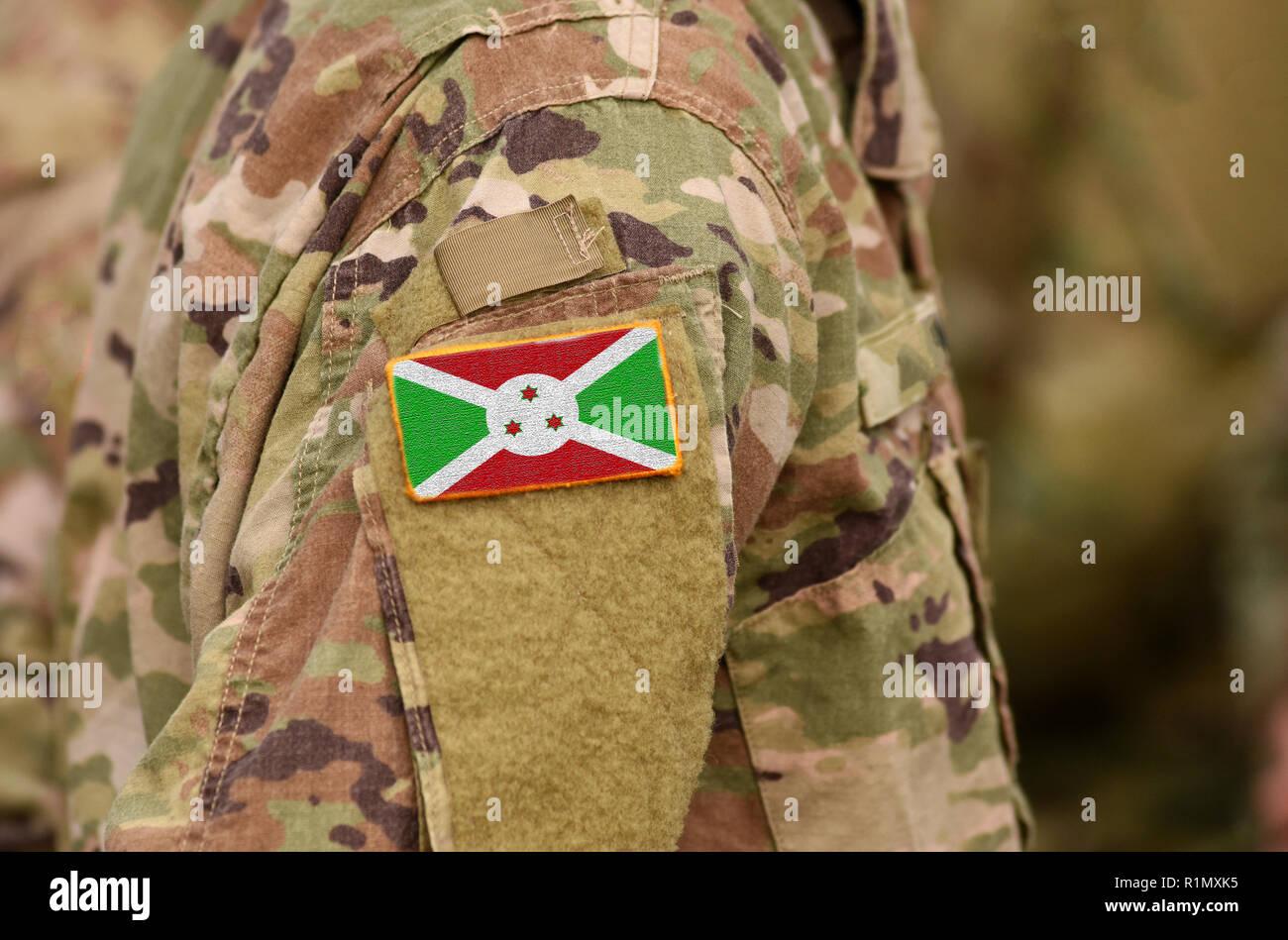 Burundi flag on soldiers arm. Republic of Burundi troops (collage) - Stock Image