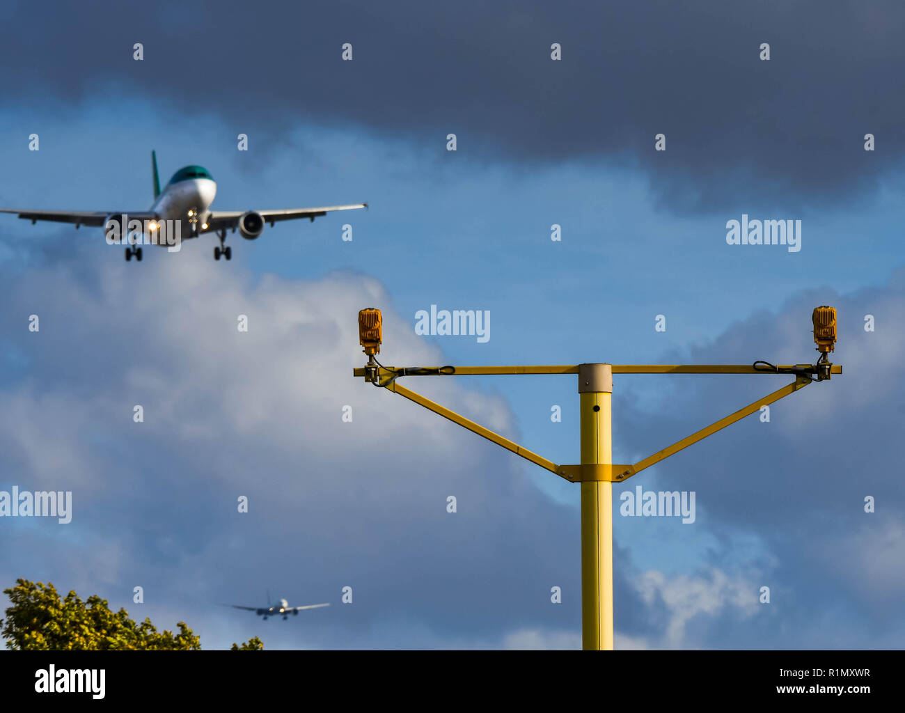 LONDON, ENGLAND - NOVEMBER 2018: Landing lights at London Heathrow Airport with an Aer Lingus jet on final approach. Another aircraft can be seen in t - Stock Image