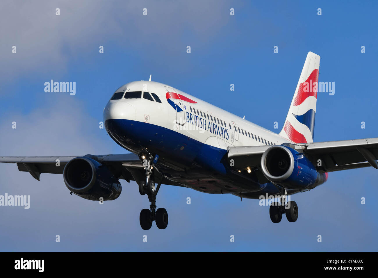LONDON, ENGLAND - NOVEMBER 2018: British Airways Airbus A319 jet on final approach for landing at London Heathrow Airport. - Stock Image