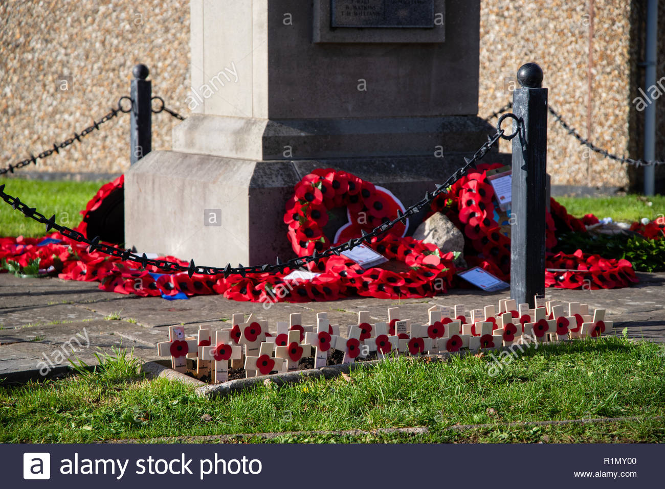 An image of Remembrance Day poppy crosses and wreaths at Rhoose Cenotaph. - Stock Image