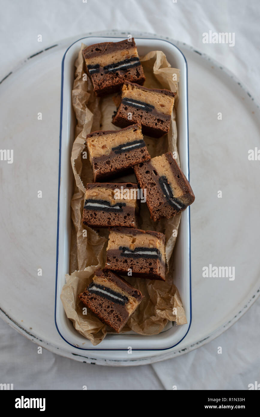 home made chocolate peanut butter brownies with cookies and cream - Stock Image