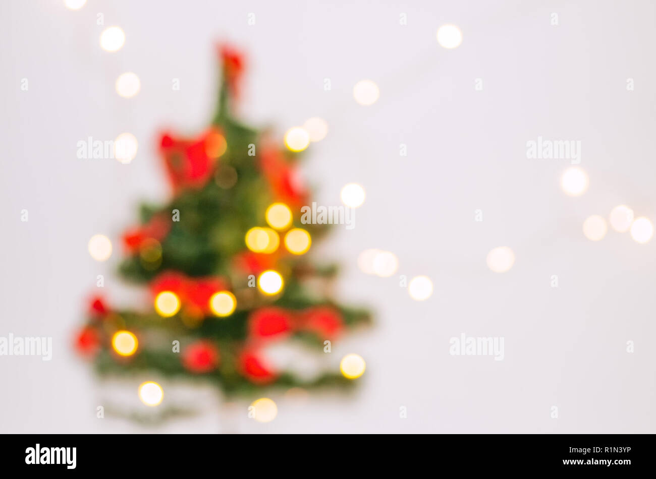Blurred Background Christmas Tree On A White Background Garland On The Wall Christmas Tree In A White Room For Christmas Stock Photo Alamy