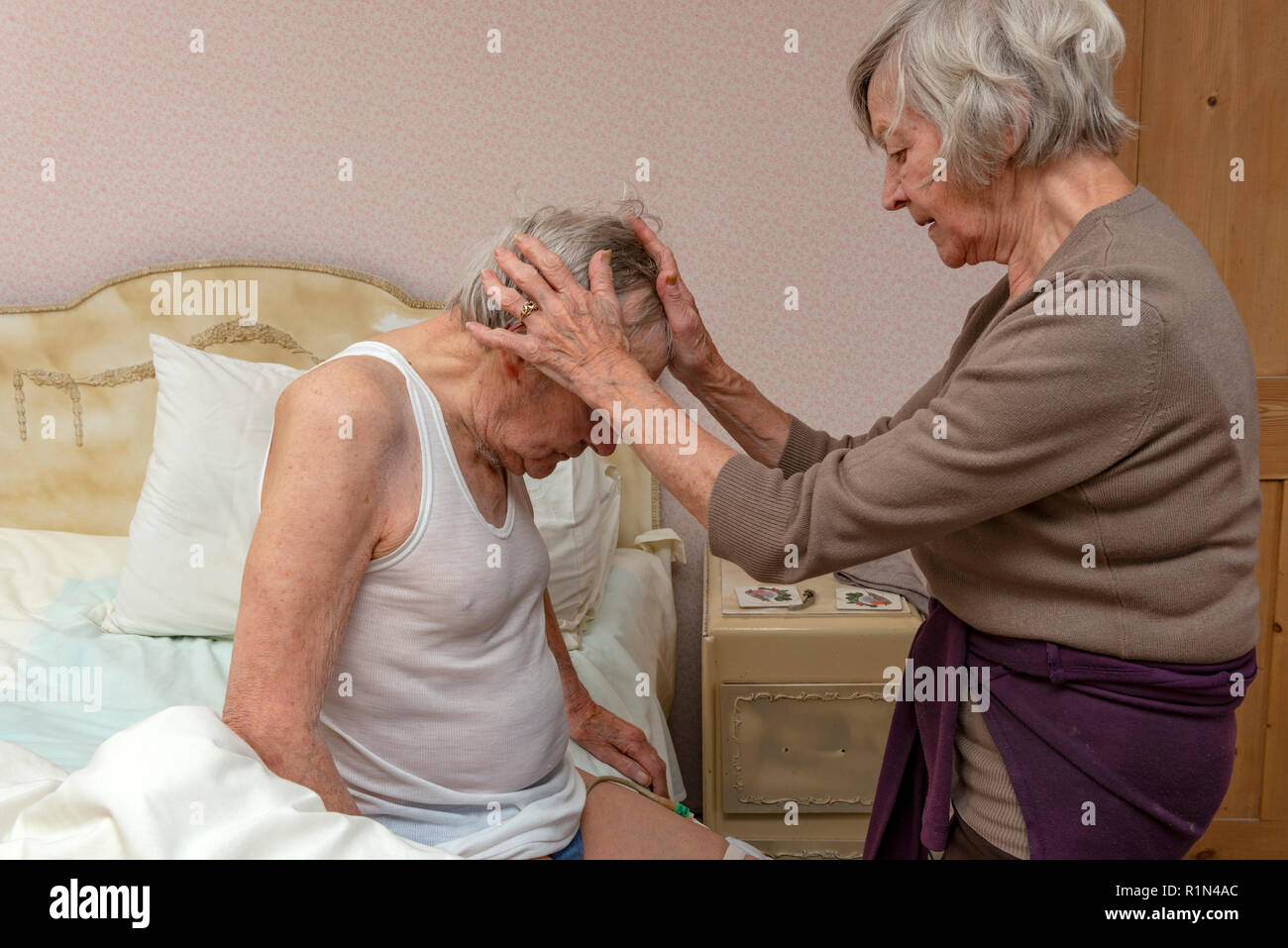 Sister Caring For Her Elderly Brother Stock Image