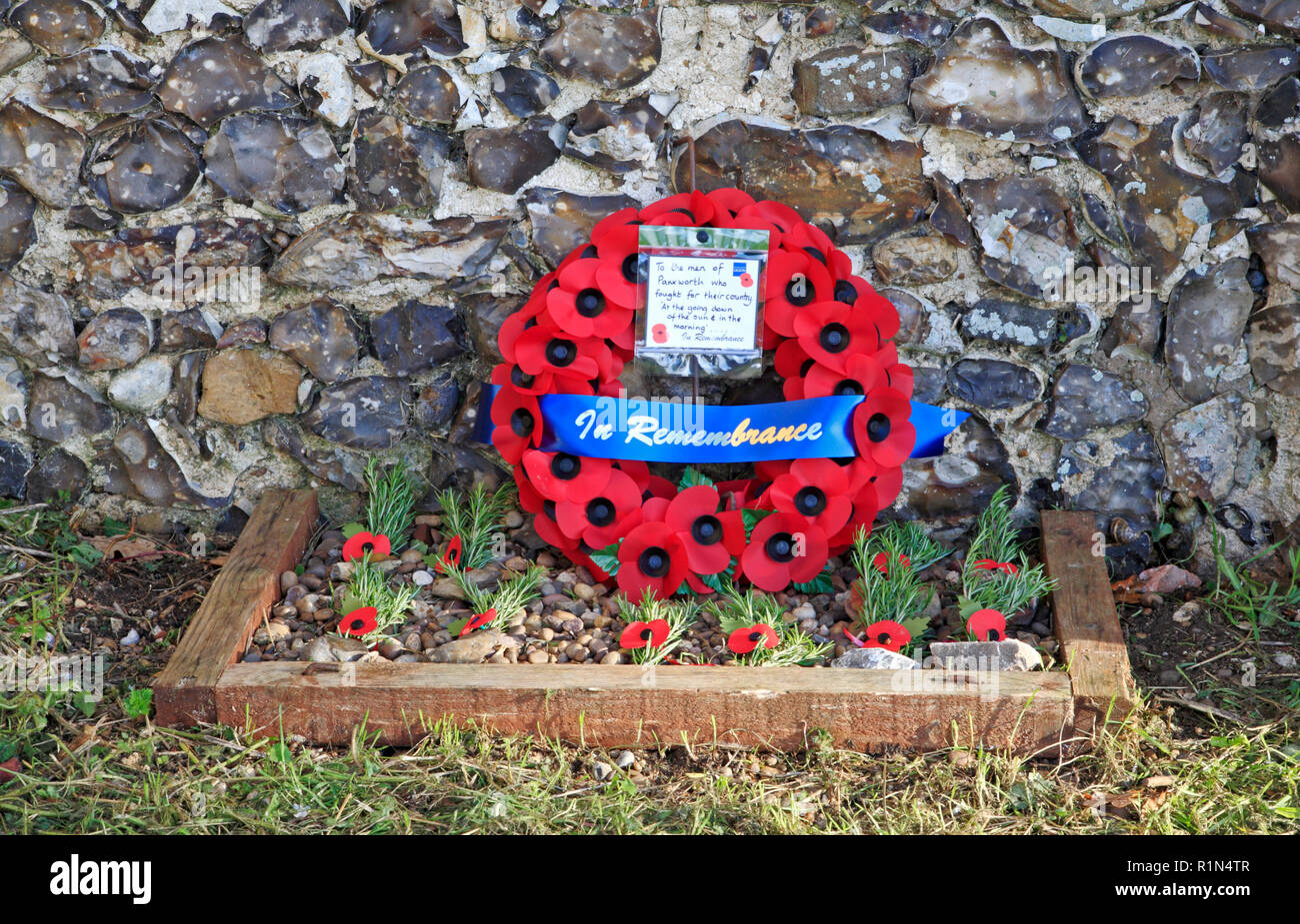 A poppy wreath and poppies to the memory of the fallen men of Panxworth, Norfolk, England, United Kingdom, Europe, on the centenary of WW1 ceasefire. - Stock Image