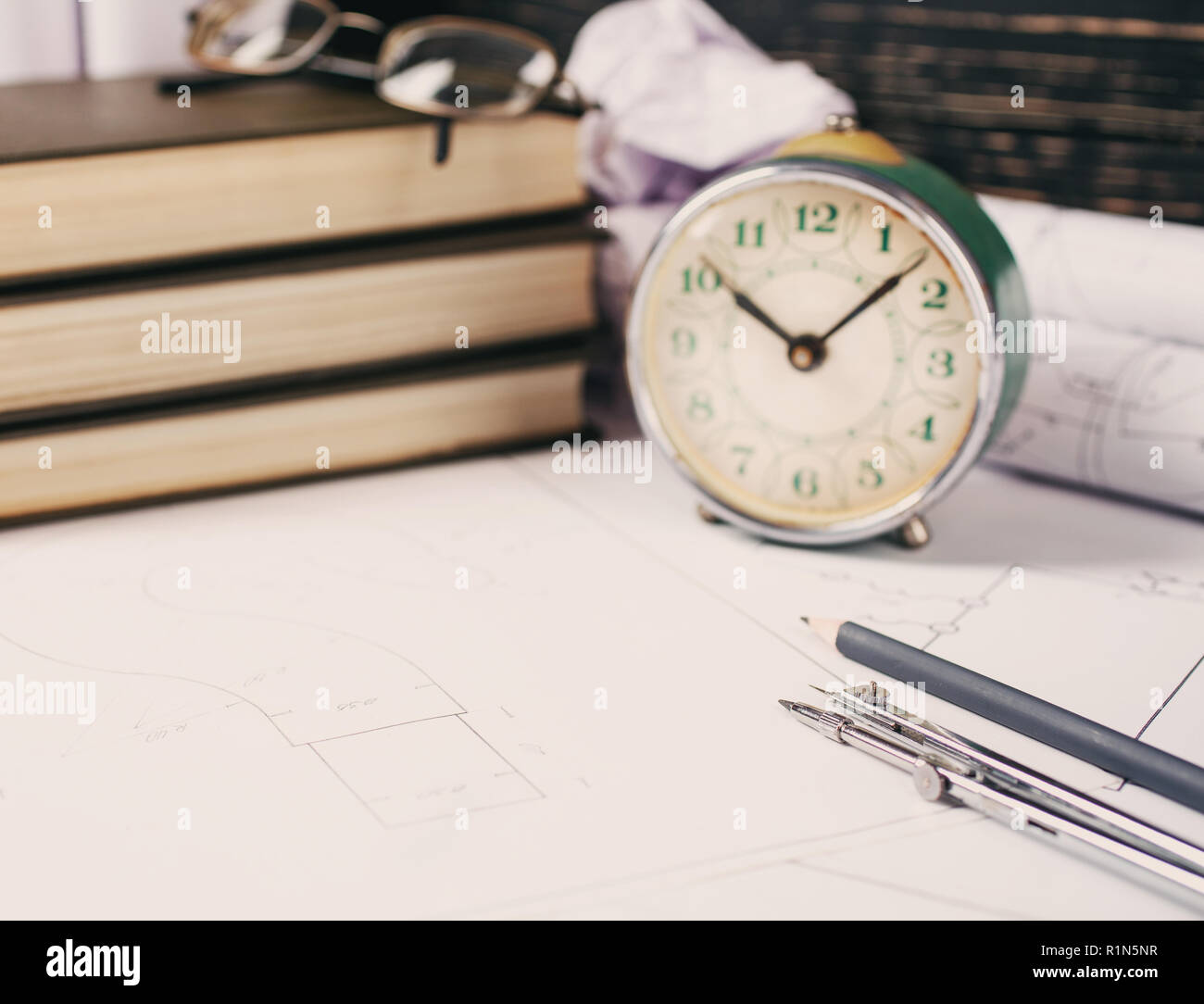 Rolls with drawings, design books and several drawing tools - Stock Image