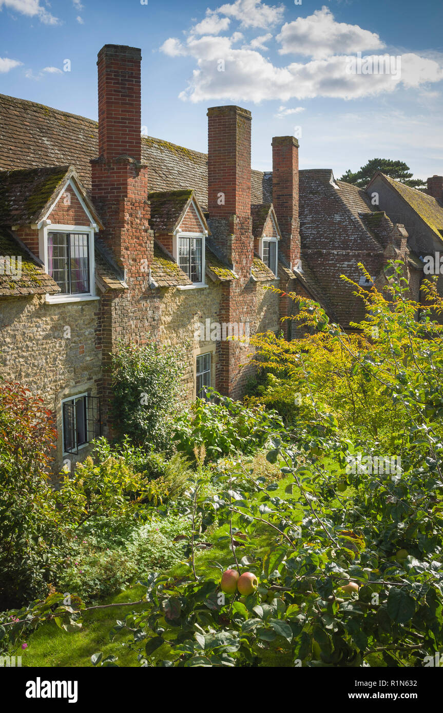 Fifteenth Century almshouses in the historic Oxfordshire village of Ewelme, Oxfordshire - Stock Image