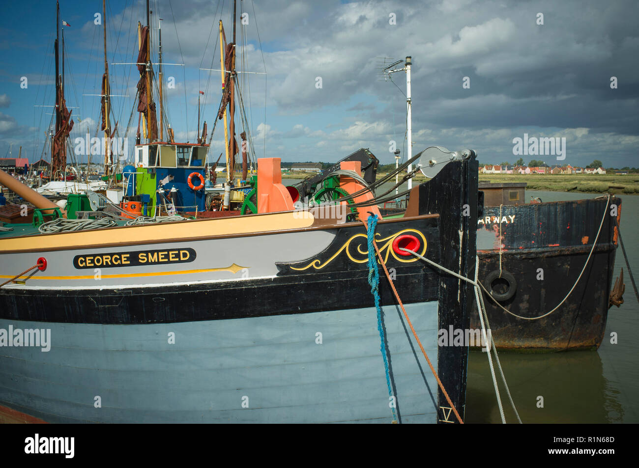 Colourful sailing barges, The Starway and the George Smeed, moored on the Blackwater Estuary at Maldon, Essex - Stock Image
