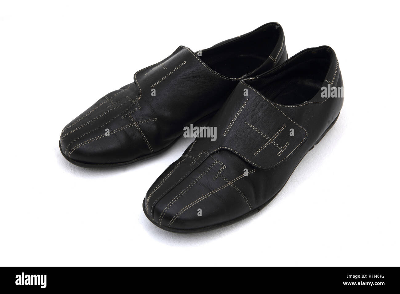 Flat Leather Shoes with Velcro Fastener - Stock Image