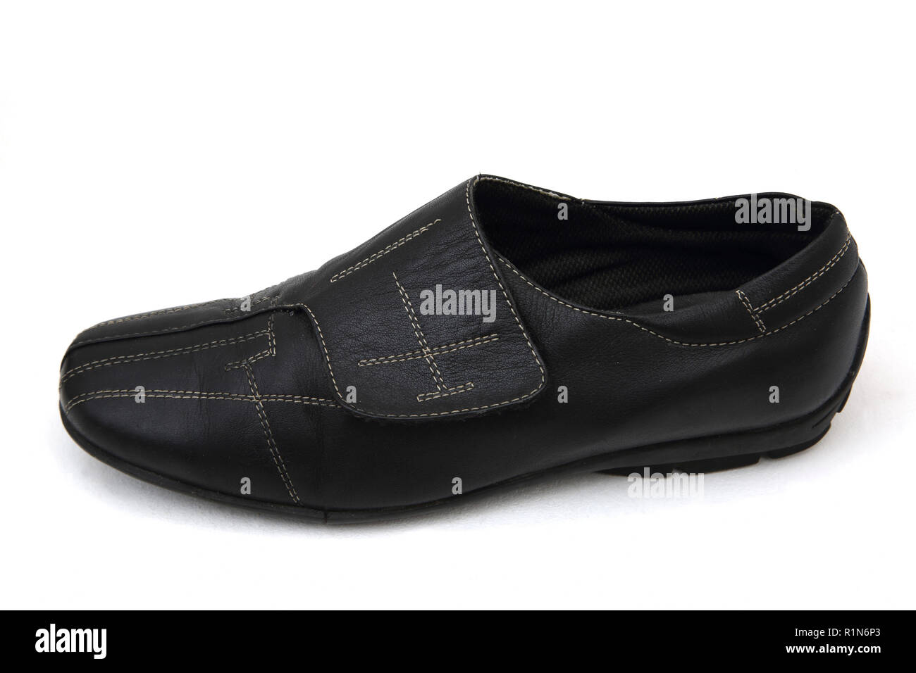 Flat Leather Shoe with Velcro Fastener - Stock Image