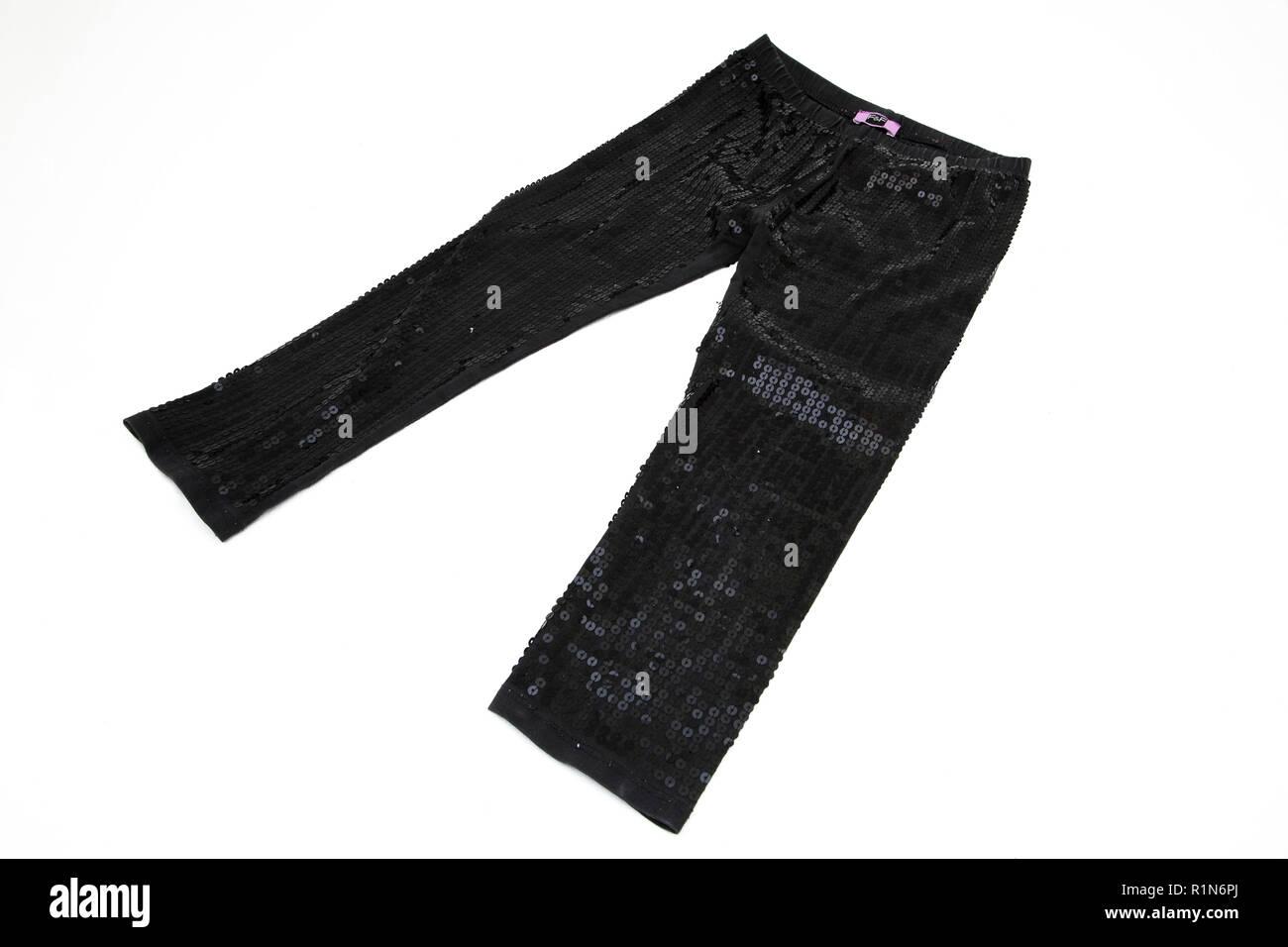 Child's Black Sequinned Leggings - Stock Image