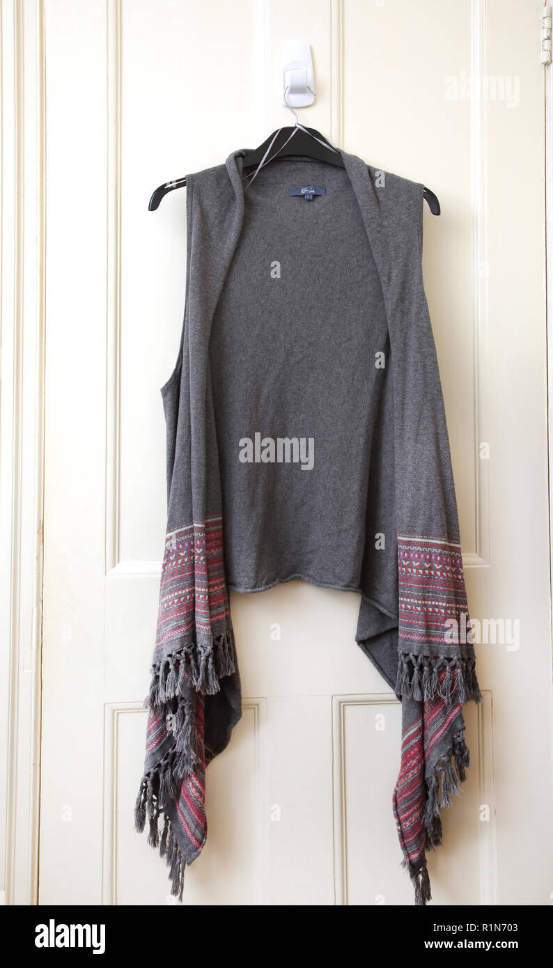 Long Sleeveless Cardigan with Tassels - Stock Image