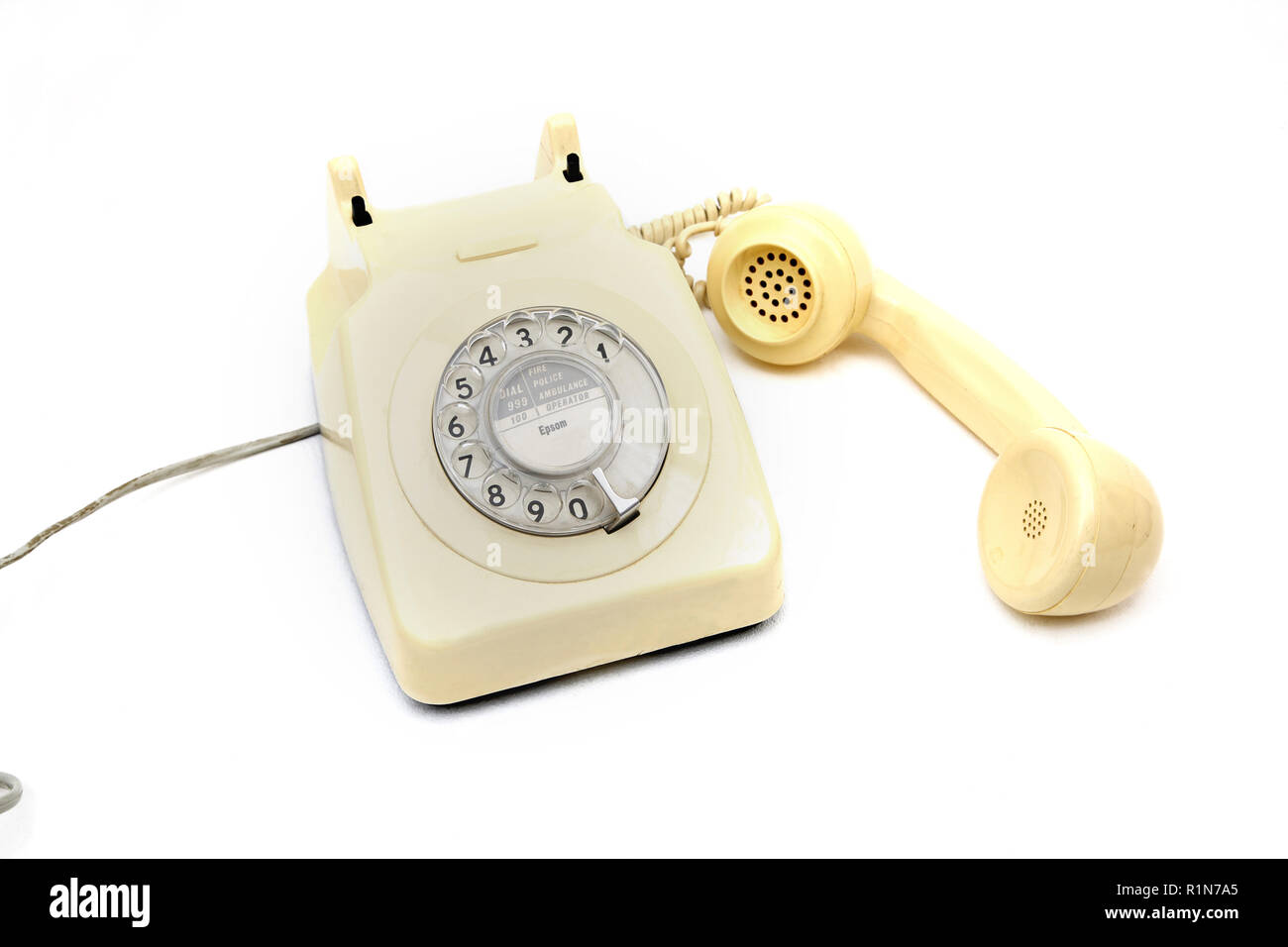 Cream Coloured Vintage Rotary Dial Telephone - Stock Image