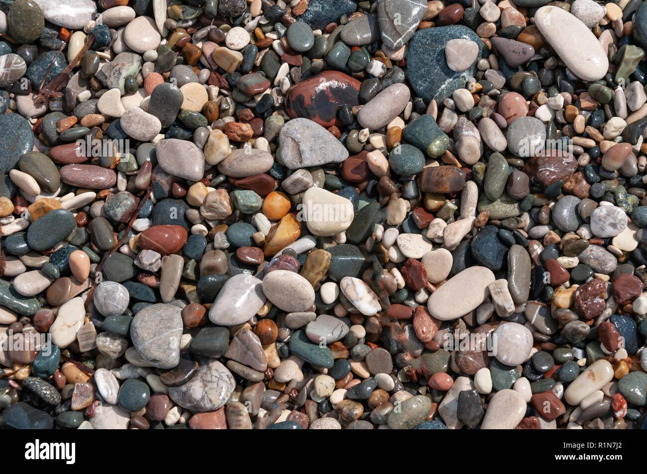 Wet pebbles on beach, Aphrodite's Beach (Petra tou Romiou), Kouklia, Pafos District, Republic of Cyprus - Stock Image