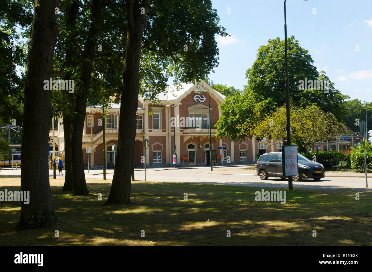 The front side of the railway station used for the Dutch Royal family with a  parked car in Baarn, the Netherlands - Stock Image