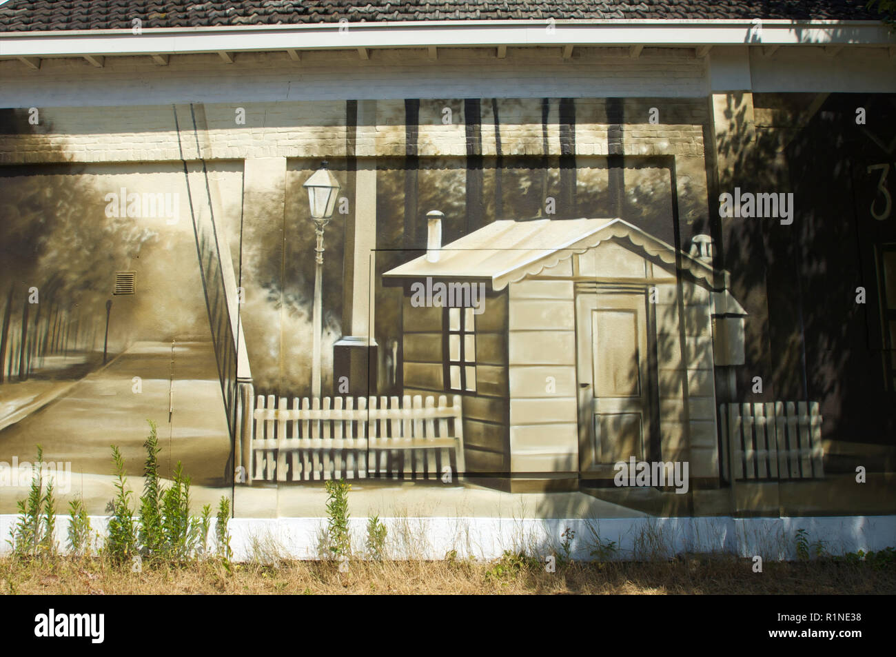 Wall painting on a house of the old railway station at the current train station in Baarn, the Netherlands - Stock Image