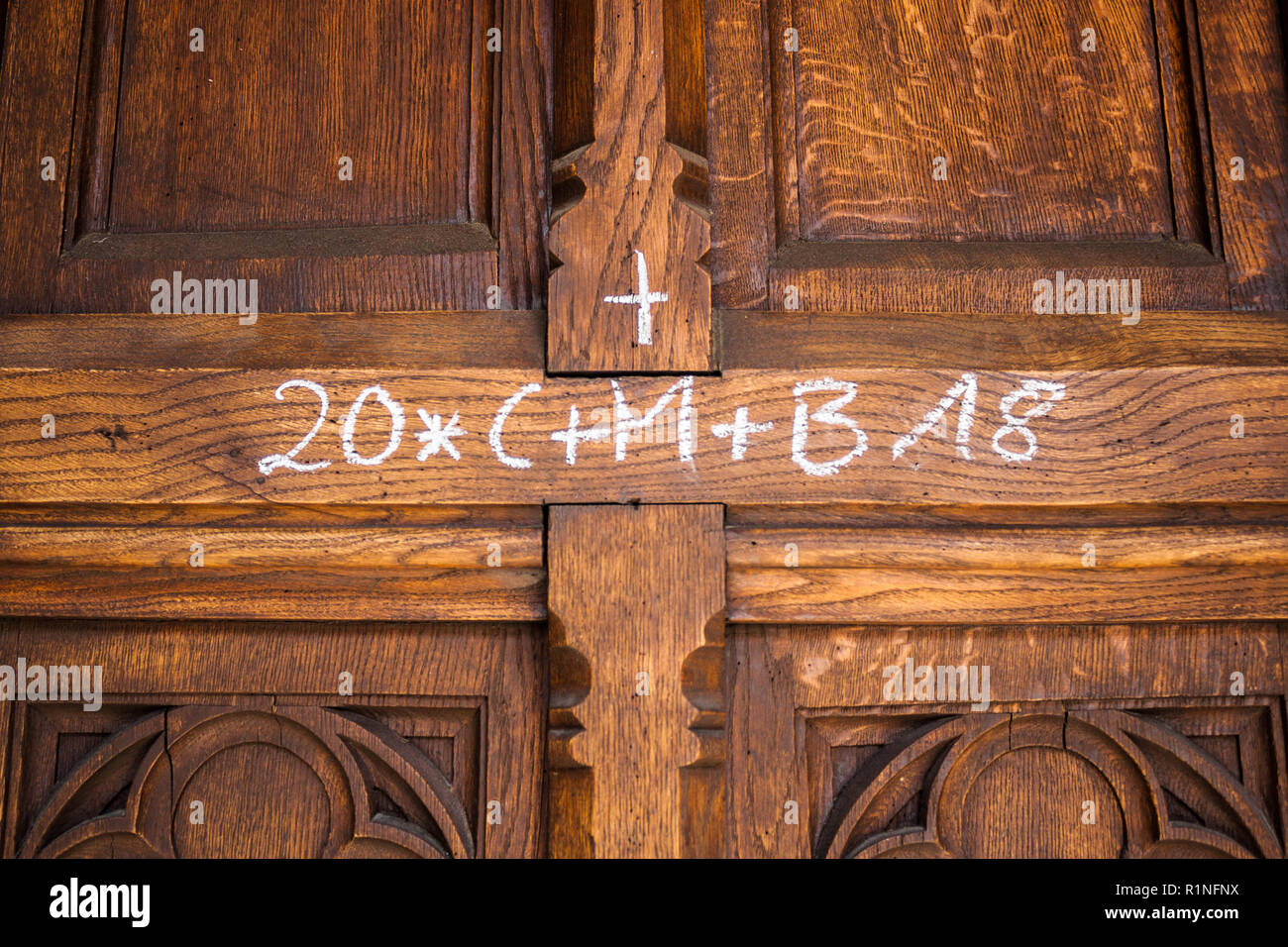 Epiphany day home blessing (Chalking the door) tradition. C, M, and B are the initials for the names of three kings (Caspar, Melchior, Balthasar) and  - Stock Image