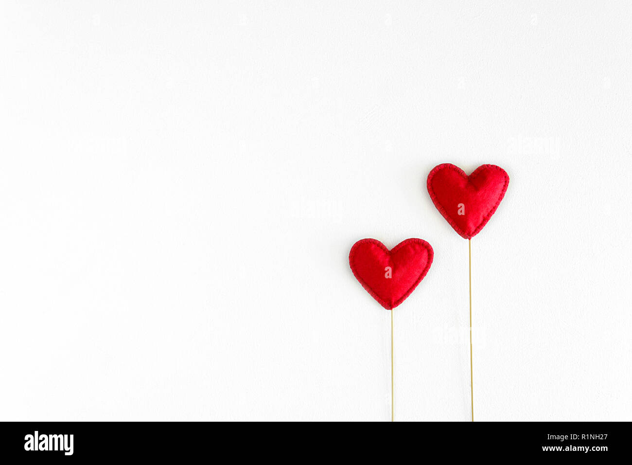 Felt love hearts on booth props on white wooden background. Valentine's day celebration concept. Top view. Flat lay. Copy space - Stock Image
