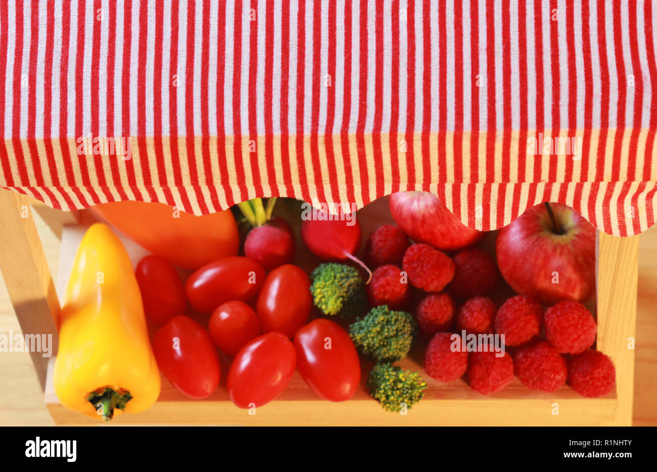 close-up of a miniature market stall with fruits and vegetables, seen from above - Stock Image