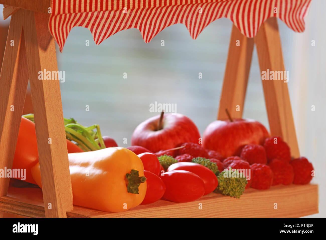 minature market stall with a variety of fruits and vegetables, side view - Stock Image