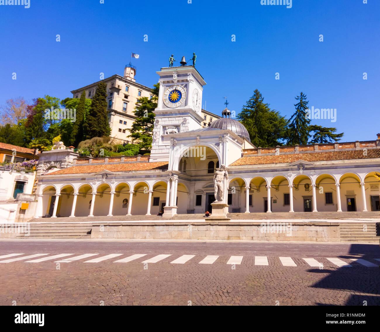 Clock tower and castle in Piazza Liberta, Udine, Friuli Venezia-Giulia, Italy - Stock Image