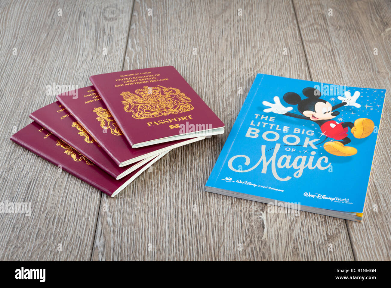 British Passports with a Disney Little Book of Magic - Stock Image
