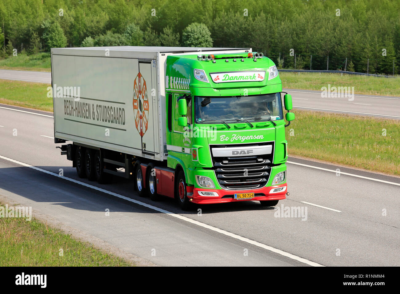 Paimio, Finland - June 1, 2018: Lime green DAF XF truck Danmark of Bo Jorgensen in front of FRC semi trailer on motorway on a sunny day of summer. - Stock Image