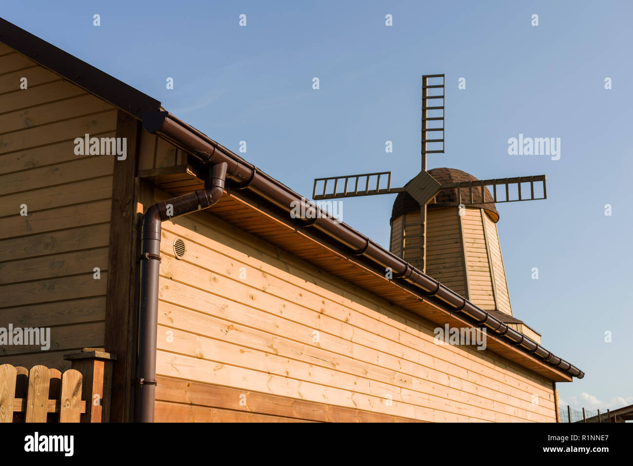 drainpipe on the edge of a wooden building - Stock Image