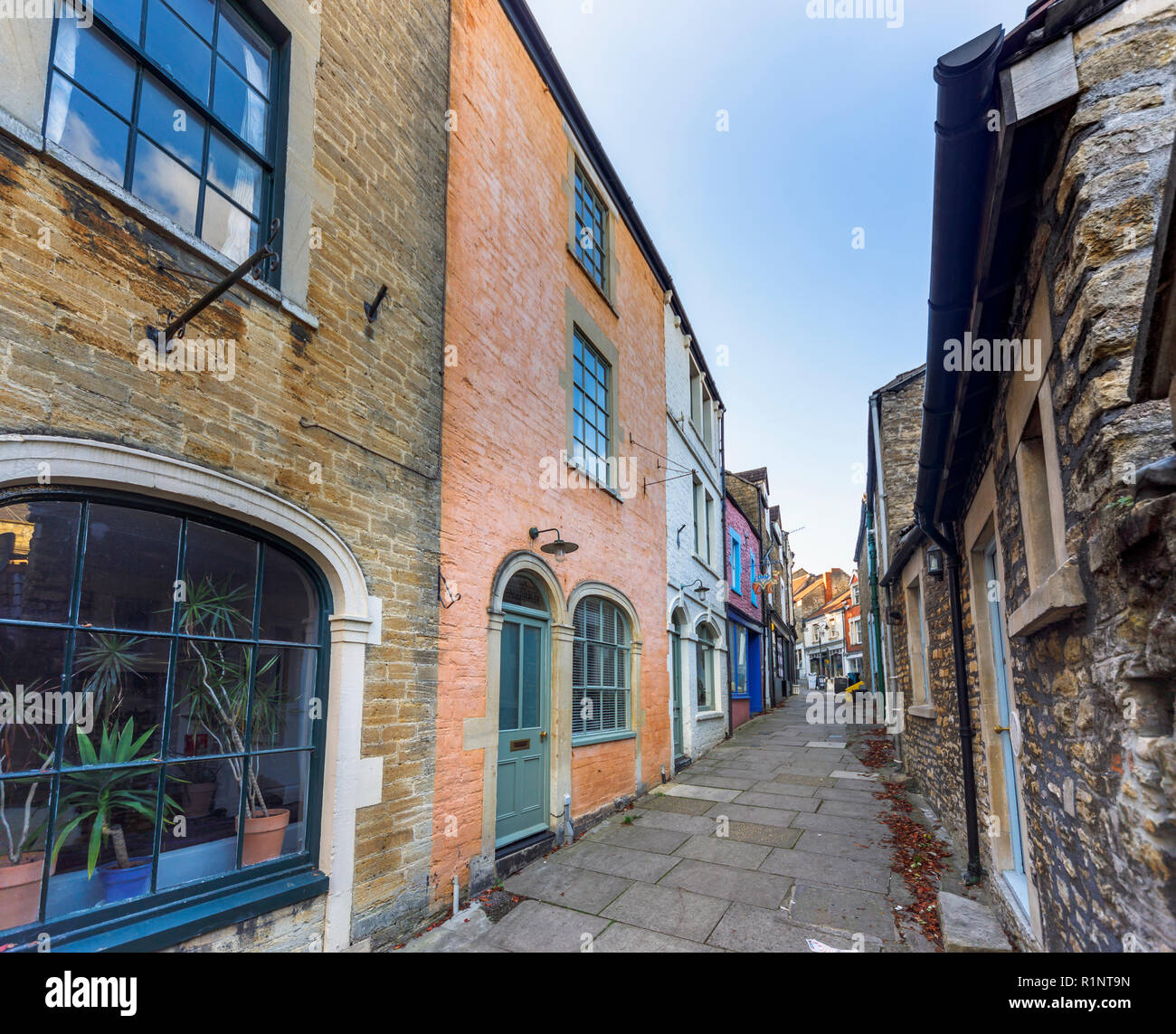 Paul Street, an alleyway off Catherine Hill with unspoilt quaint buildings and shops in the small eastern Somerset town of Frome, south-west England Stock Photo