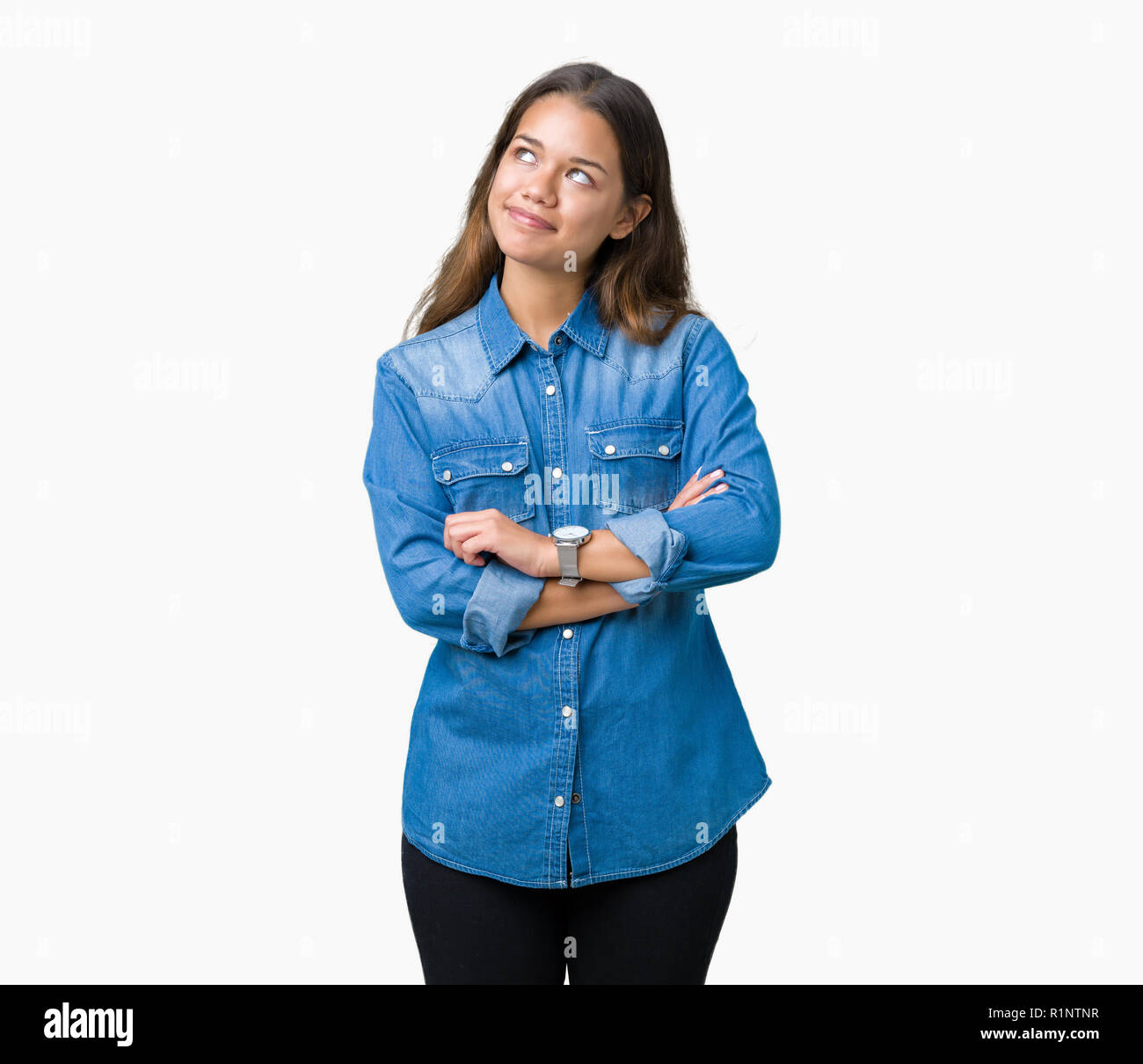 edf002a668 Young beautiful brunette woman wearing blue denim shirt over isolated  background smiling looking side and staring away thinking.