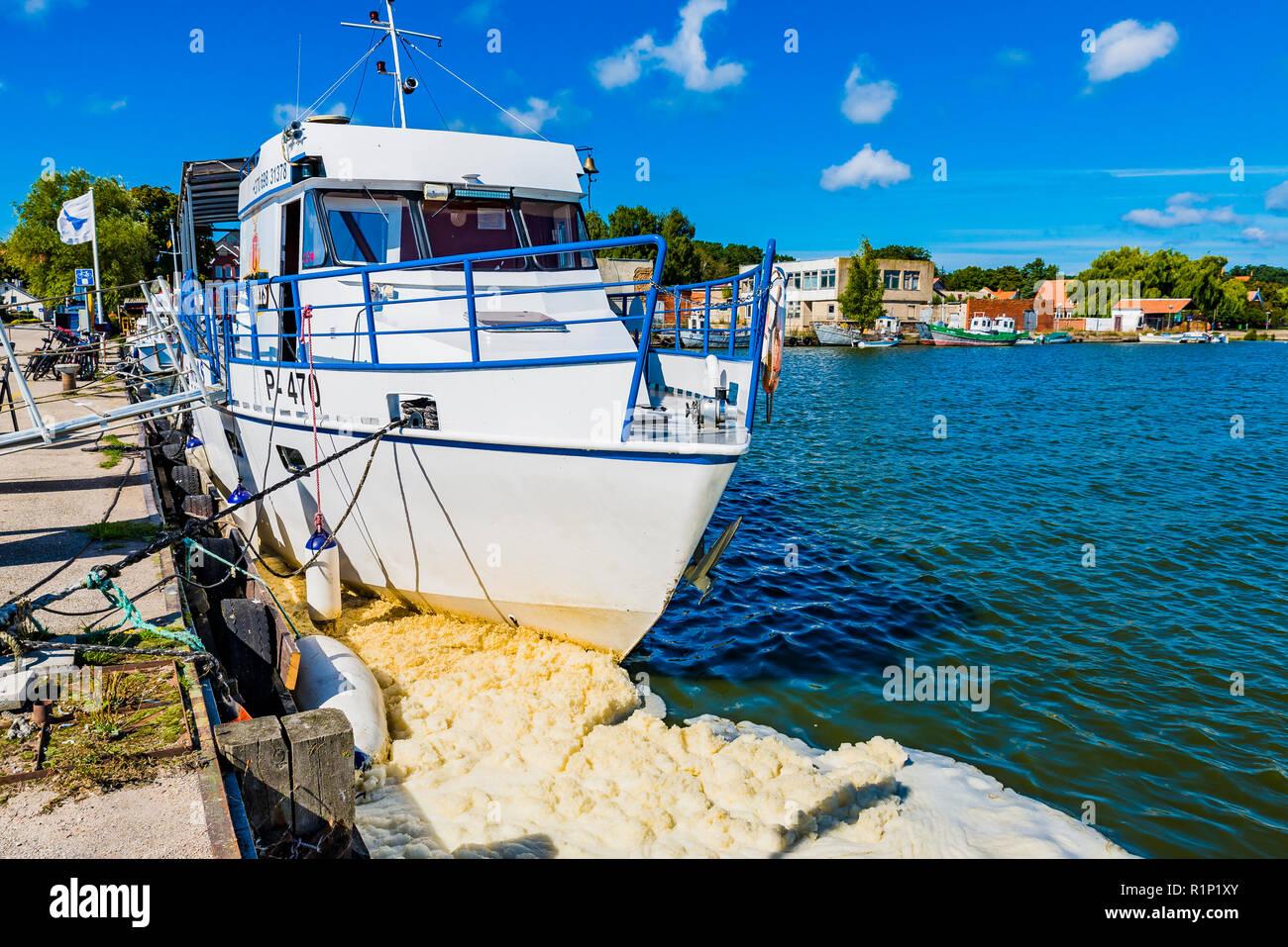 Contaminated foams in the port. Nida, Neringa Municipality, Klaipeda County, Lithuania, Baltic states, Europe. - Stock Image