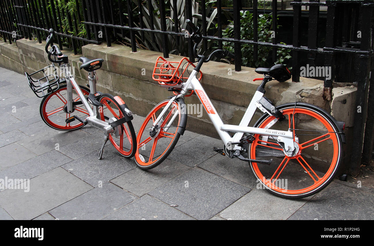 Mobikes on the street in Newcastle upon Tyne - Stock Image