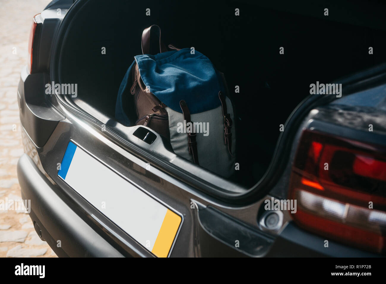 Backpack in the trunk of a car. Preparation for the trip. The concept of tourism or travel by car. - Stock Image