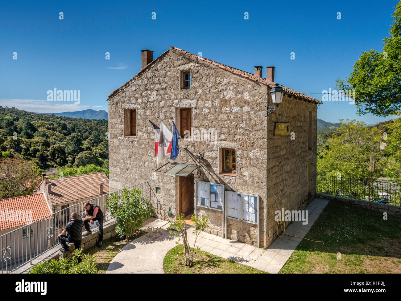 Two local men at Town Hall in village of Aullene, Alta Rocca microregion, Corse-du-Sud, Corsica, France - Stock Image