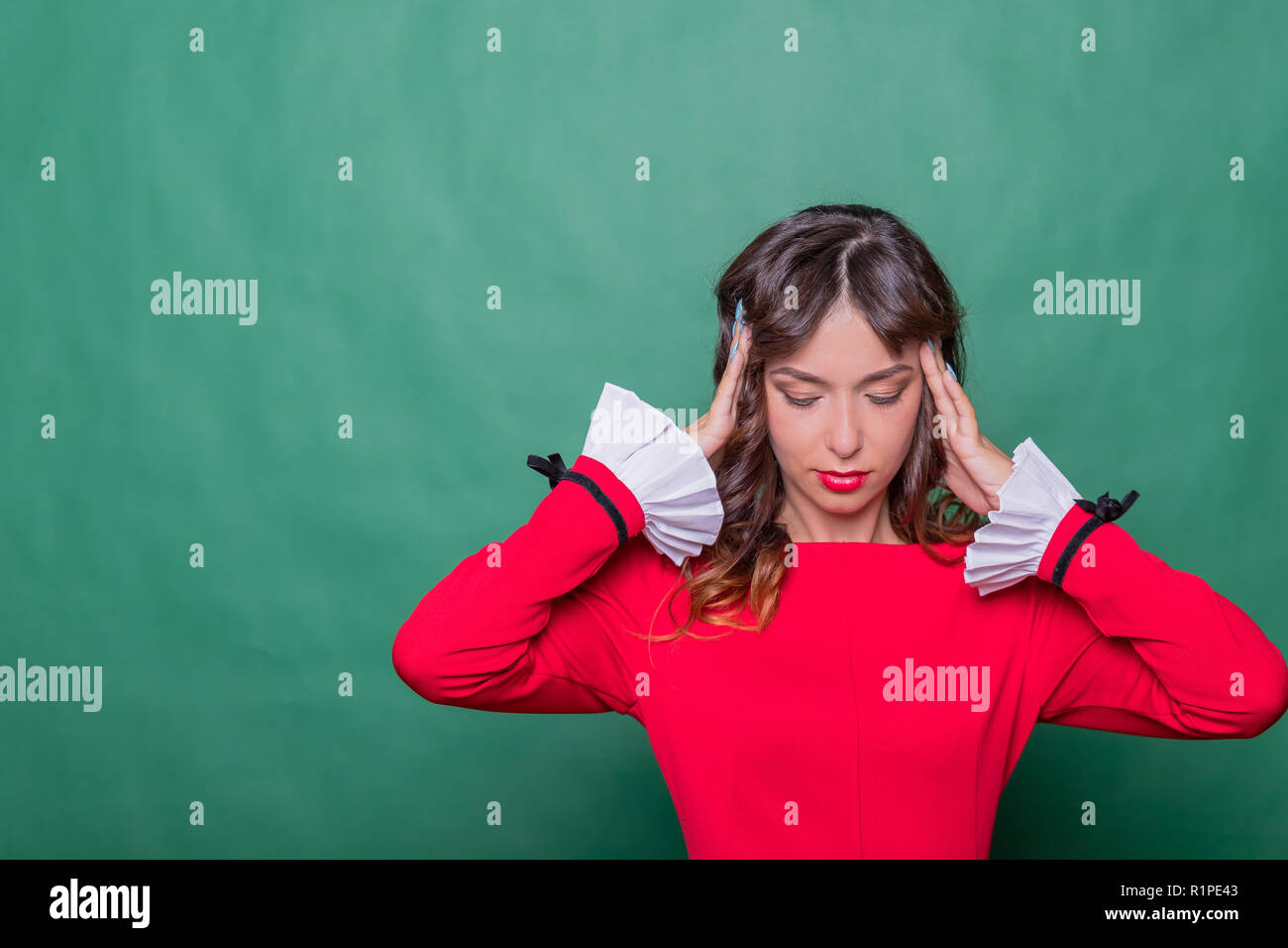 Business woman having a head pain. Stress and depression.Health And Pain. Stressed Exhausted Young Woman Having Strong Tension Headache. Portrait Of Beautiful Sick Girl Suffering From Head Migraine, Feeling Pressure in job.Copy space - Stock Image