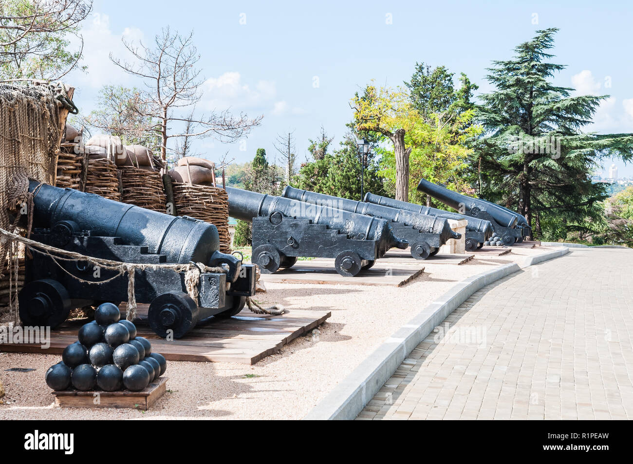 Old guns and cores of the defensive fort is a military museum. - Stock Image