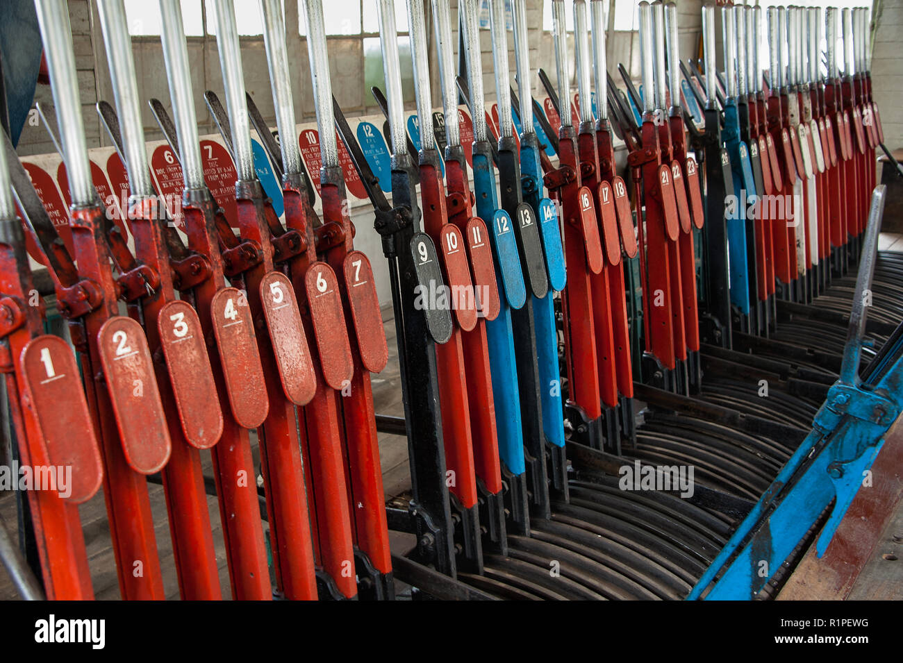 Mechnical levers used to operate railway signals and points, ensuring safe rail travel - Stock Image